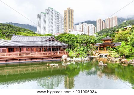 Blue Pond and Pavilion Bridge at Nan Lian Garden a Chinese Classical Garden in Diamond Hill Kowloon Hong Kong. The public park has an area of 3.5 hectares and was designed after the Tang Dynasty style of architecture.