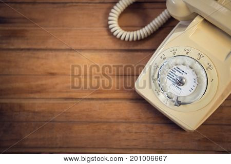 Close up of landline phone on wooden table