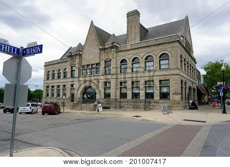 CADILLAC, MICHIGAN / UNITED STATES - MAY 31, 2017:  The old Cadillac City Hall building now houses the Cadillac Area Visitors Bureau in downtown Cadillac.
