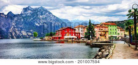 Alpine scenery - beautiful lake Lago di Garda and village Torbole. italy