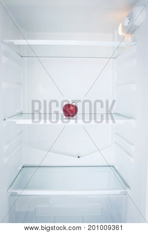 Close up of apple in illuminated refrigerator