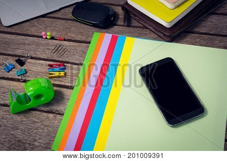 High angle view of laptop and digital tablet with office supplies on wooden table