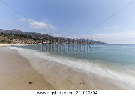 Malibu beach with motion blur surf near Los Angeles in Southern California.