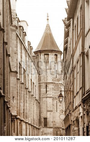 Saint Romain street by the Notre-Dame cathedral in old historic part of Rouen, France