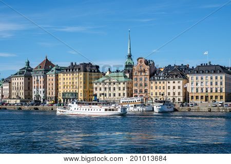 STOCKHOLM, SWEDEN - JULY 6, 2017: View towards historic Old Town from Skeppsholmen bridge in Stockholm. The capital city of Sweden is built on 17 islands.