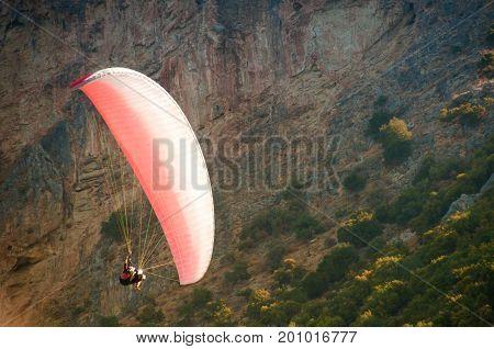 Paraglider flies paraglider in the sky. Paragliding