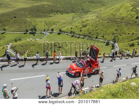 Col de PeyresourdeFrance- July 23 2014: Vittel vehicle during the passing of the Publicity Caravan on the road to Col de Peyresourde in Pyrenees Mountains in the stage 17 of Le Tour de France on 23 July 2014.Vittel is a French bottled water brand.