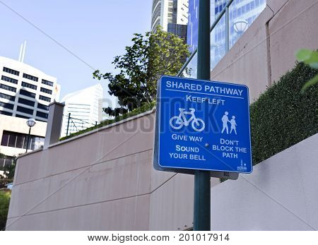 BRISBANE, AUSTRALIA - June 22, 2017: Shared pathway sign as seen on the Riverside pathway in Brisbane Australia