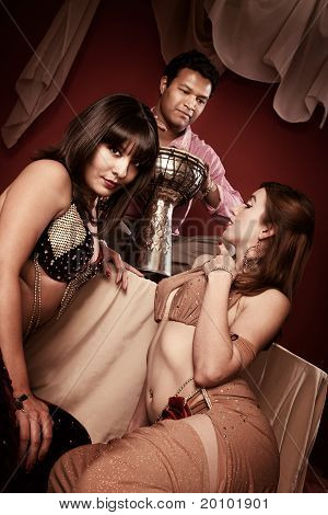Belly Dancers With Tabla Player