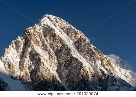 Pumori Mountain Peak On The Famous Everest Base Camp Trek In Himalayas, Nepal. Snowy Mountain Summit