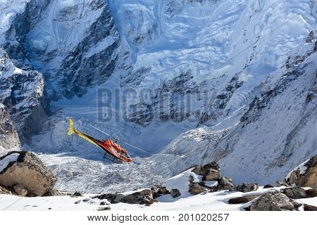 Everest Base Camp Trek/nepal - October 31, 2015: Rescue Helicopter In High Himalayan Mountains. Red