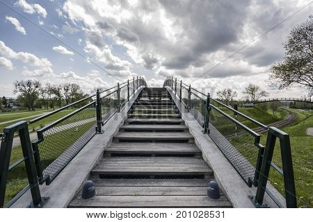 Zamosc - Renaissance city in Central Europe. Footbridge above a railway line.