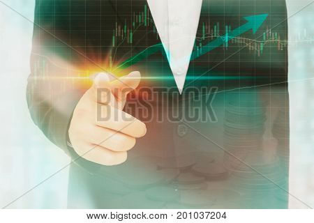 Businessman touching or pointing to an analytic finance graph