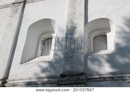 Courtyard of Spaso-Prilutsky Monastery in the Vologda city, Russia. Summer sunny day. White church. Part of the building