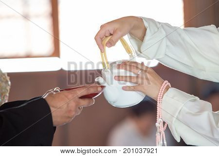 Poured sake for drink sake ceremony in japanese buddhist nichiren or shinto wedding ceremony