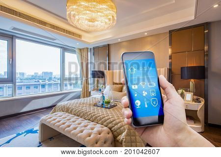 mobile phone with smart home app in modern bedroom