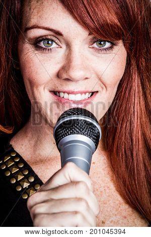 Beautiful smiling singing redhead woman