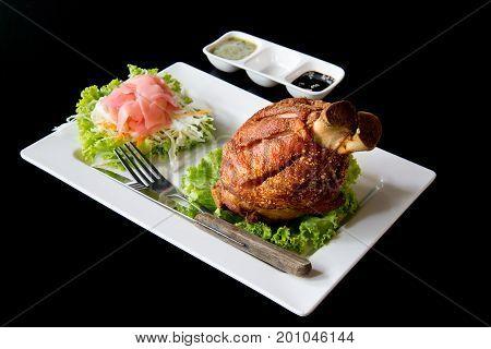 German Pork Hocks German Pork Hocks with sauce on black background