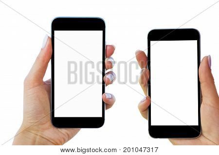 Beautiful Woman hands holding two smart phone with isolated white screen. Business workplace with copy space. Empty space for text. Isolated screen for mock up. Left and right hand