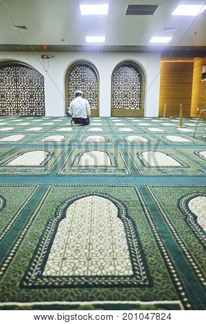 Dhaka, bangladesh, august 2017- a muslim man praying at inside of a mosque located at bodhundhora in dhaka in bangladesh taken on 24 august 2017