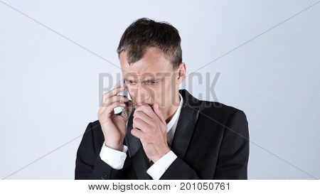 Furious businessman on the phone, White Background