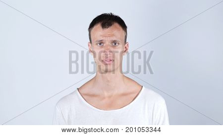 Closeup Portrait Of Confused Clueless Young Man
