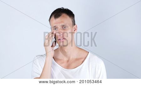 Portrait Of  Man Speaking On His Cell Phone ,jobless  Sad, Rejection Of His Work