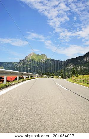 Road in the Tyrolean Alps in the direction of the mountain Aggenstein