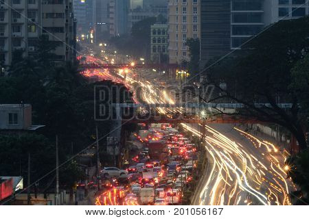 Dhaka, bangladesh, august 2017-light trails and traffic jam with city buildings located at motijhil area in dhaka in bangladesh taken on 24, august 2017
