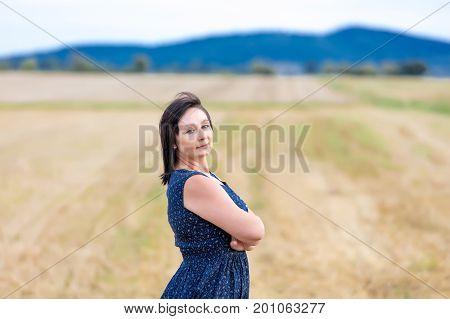 Portrait Of Senior Woman At Autumn Wheat Field
