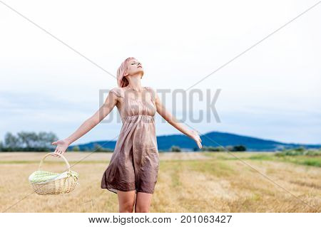 Portrait Of Woman With Basket