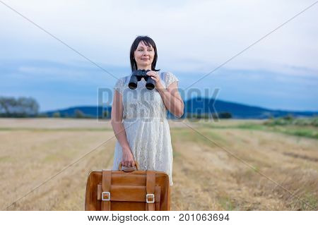 Portrait Of Senior Woman With Travel Suitcase