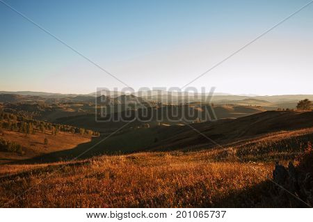Beauty sunset in the mountains in Altay, panoramic picture
