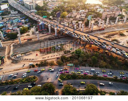 Traffic jam in rush hour expressway. Freight and passenger train waiting at the train station parking lot.Cargo transit.import export and business logistic.Aerial view.Top view. Railway construction