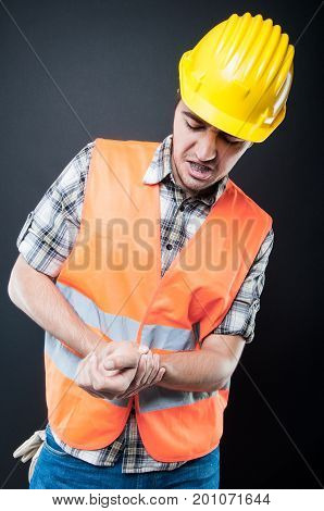 Portrait Of Constructor Holding His Wrist Like Hurting