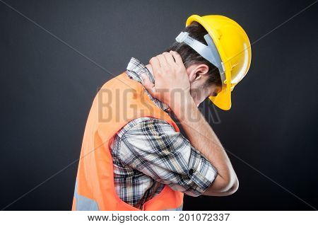 Side View Of Constructor Holding Neck Like Hurting
