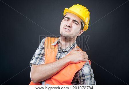 Portrait Of Constructor Holding Shoulder Like Hurting