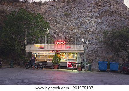 ATHENS GREECE - JULY 07 2017: View at small kiosk at parking of Likavitos open theater at Likavitos hill Athens Greece at night