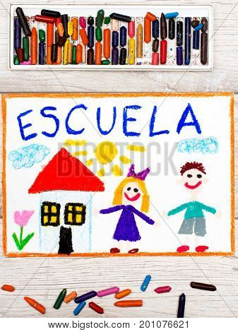 Photo of colorful drawing: Word SCHOOL school building and happy children. First day at school.