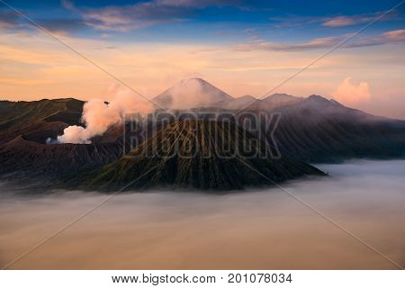 Mount Bromo volcano (Gunung Bromo) during sunrise from viewpoint on Mount Penanjakan. Mount Bromo located in Bromo Tengger Semeru National Park East Java Indonesia.