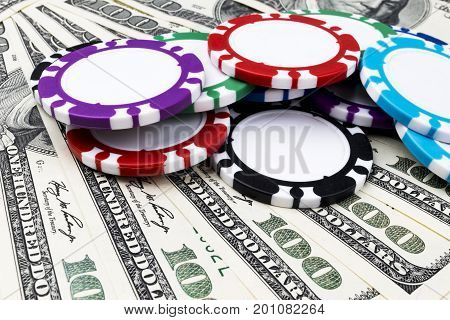 Stack of Poker chips on a dollar bills Money. Poker table at the casino. Poker game concept. Playing a game with dice. Casino Concept. Concept for business risk. chance good luck