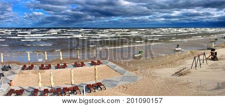 Summer storm at sandy beach of the Baltic Sea, Europe. Panoramic view