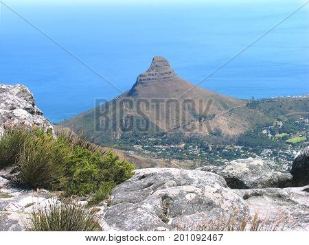 FROM CAPE TOWN, SOUTH AFRICA, VIEW OF LIONS HEAD ON A CLEAR SUMMER DAY,  FROM THE SUMMIT OF TABLE MOUNTAIN