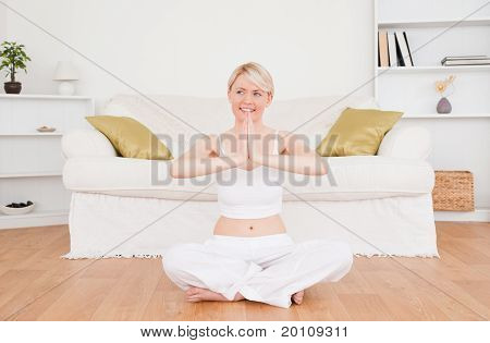 Attractive Blond-haired Woman Practicing Yoga