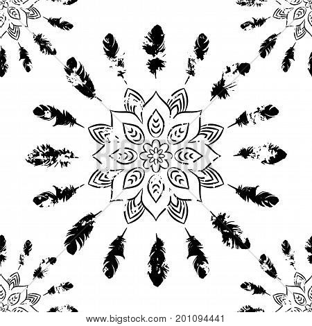 Seamless pattern with black mandalas and feathers on white. Ethnic American Indian pattern. Vector background.
