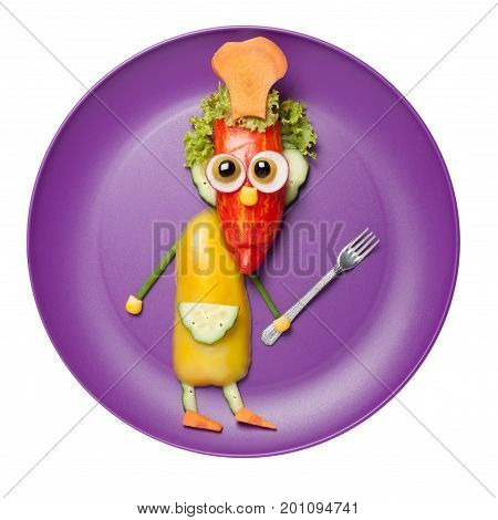 Chief made of fresh vegetables on purple plate