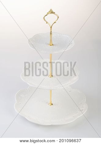 Tray Or Three Tier Serving Tray On A Background.