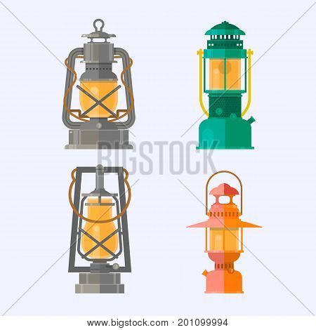 Retro gas lamps with glowing fire wick.Vintage camping lantern isolated on white background. Different oil lamp collection.