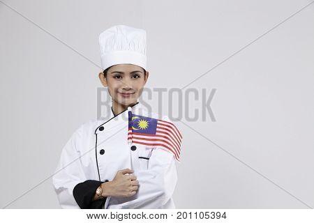 malay chef holding small malaysia flag