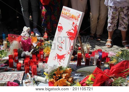 BARCELONA/SPAIN - 18 AUGUST 2017: People reunited on Barcelona's Rambla, where the previous day there has been a terrorist attack, giving tribute to the at least 14 fatal victims and over 80 injured. Credit: Dino Geromella / BigStock